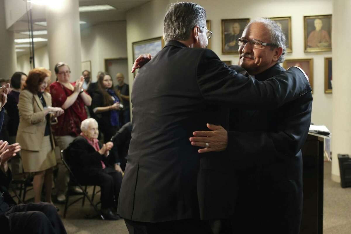Monsignor Michael Joseph Boulette, right, hugs Archbishop Gustavo García-Siller, after Boulette's appointment as auxiliary bishop of the Archdiocese of San Antonio was announced Monday. Boulette has been a priest for more than 40 years and was most recently with Notre Dame Parish in Kerrville.