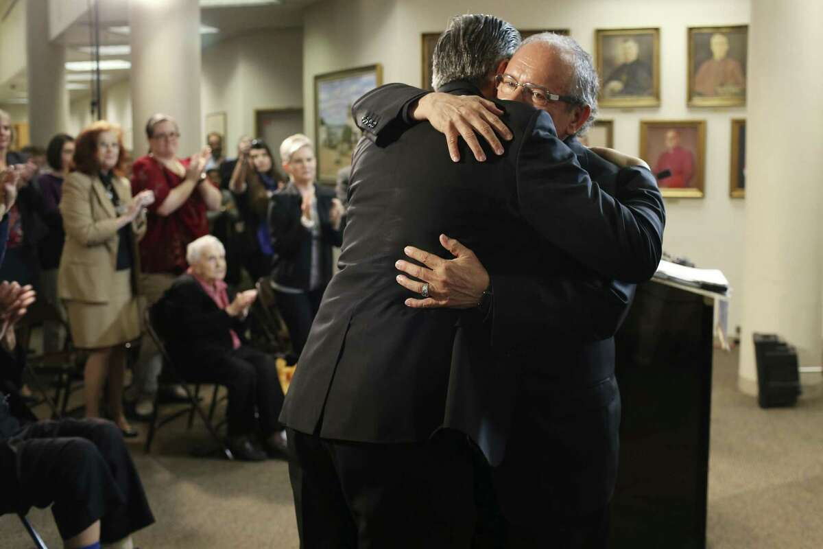 Monsignor Michael Joseph Boulette, right, hugs Archbishop Gustavo García-Siller at a press conference announcing Boulette's appointment as auxiliary bishop of the Archdiocese of San Antonio. Boulette is founding director of St. Peter upon the Water: A Center for Spiritual Direction and Formation in Ingram.