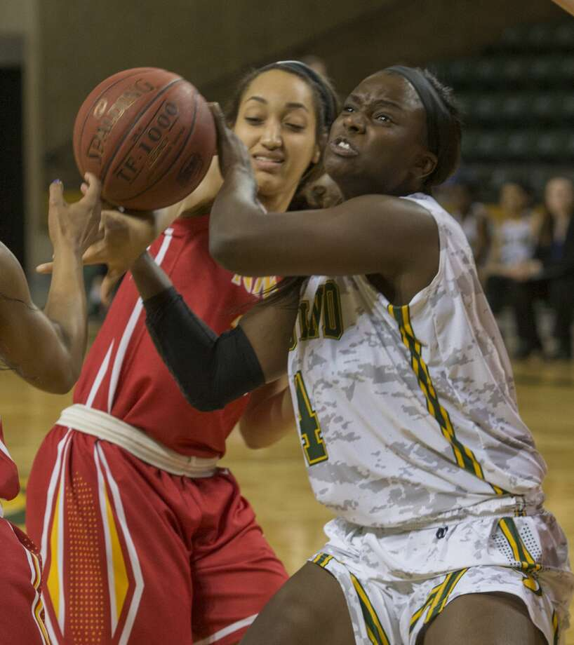 Midland College's Teneshia Dixon tries to drive to the basket as New Mexico Junior College's Alexis Winters is called for a hold Monday 01-23-17 at the Chaparral Center. Tim Fischer/Reporter-Telegram Photo: Tim Fischer/Midland Reporter-Telegram