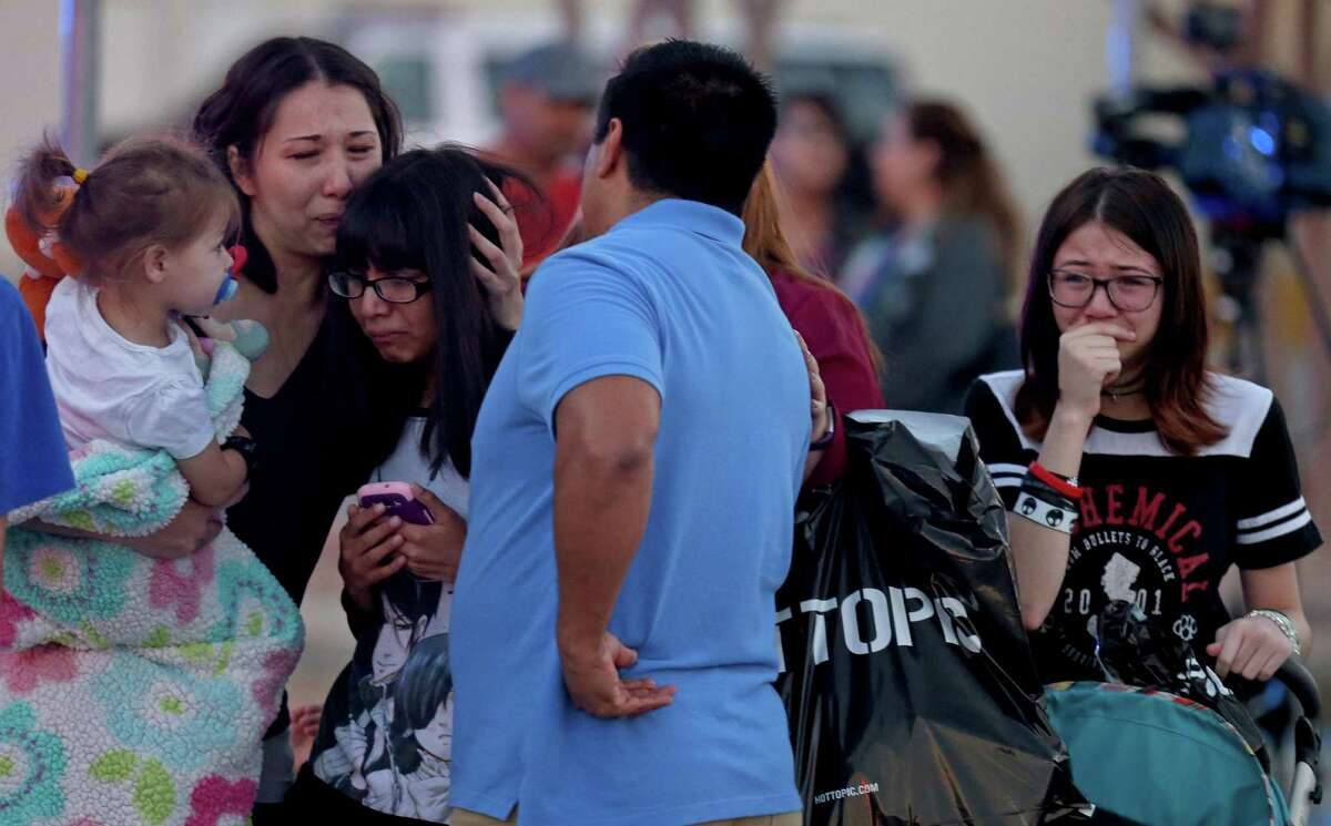 Family members reunite after exiting Rolling Oaks Mall, Sunday, Jan. 22, 2017 following a shooting inside the mall. The total number of crimes committed against jewelry businesses in the U.S. fell by almost 15 percent from 1,381 in 2014 to 1,177 in 2015, according to the latest available data from New York-based Jewelers' Security Alliance.