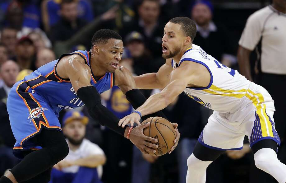 Golden State Warriors' Stephen Curry, right, defends Oklahoma City Thunder's Russell Westbrook during the second half of an NBA basketball game Wednesday, Jan. 18, 2017, in Oakland, Calif. (AP Photo/Marcio Jose Sanchez) Photo: Marcio Jose Sanchez, Associated Press
