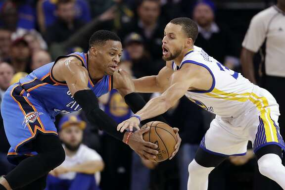Golden State Warriors' Stephen Curry, right, defends Oklahoma City Thunder's Russell Westbrook during the second half of an NBA basketball game Wednesday, Jan. 18, 2017, in Oakland, Calif. (AP Photo/Marcio Jose Sanchez)