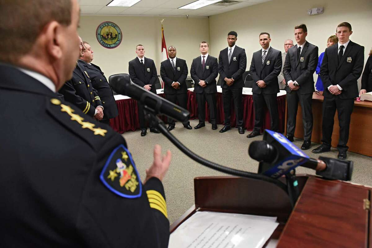Troy Police Chief John Tedesco, foreground, welcomes seven new police officers from left, Jonathan Kebea, Stephen Bell, Corey Otterbeck, Jalen Turner, Kevin Ray, Joshua Szpila and Adam Harbour at a swearing-in ceremony for seven new police officers on Monday, Jan. 23, 2017 in Troy, N.Y. (Lori Van Buren / Times Union)