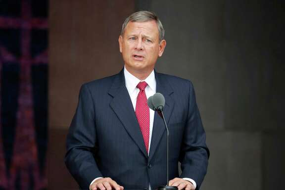 FILE - In this Sept. 24, 2016 file photo, U.S. Chief Justice John Roberts speaks at the dedication ceremony for the Smithsonian Museum of African American History and Culture on the National Mall in Washington. Roberts will administer the presidential oath to President-elect Donald Trump on Friday, Jan. 20, 2017. (AP Photo/Pablo Martinez Monsivais, File)