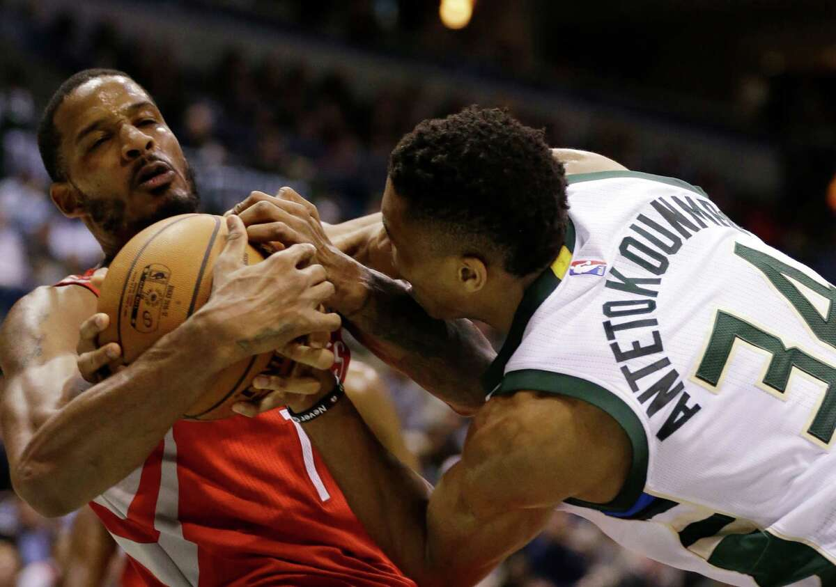 Milwaukee Bucks' Giannis Antetokounmpo, right, fights for a rebound with the Houston Rockets' Trevor Ariza, left, during the second half of an NBA basketball game Monday, Jan. 23, 2017, in Milwaukee. (AP Photo/Jeffrey Phelps)