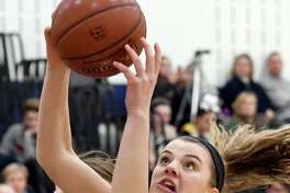 Averill Park's Kelsey Wood, center, gets the rebound during their basketball game against Shen on Friday, Dec. 9, 2016, at Averill Park High in Averill Park, N.Y. (Cindy Schultz / Times Union)