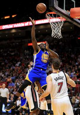 MIAMI, FL - JANUARY 23: Draymond Green #23 of the Golden State Warriors drives over Goran Dragic #7 of the Miami Heat during a game  at American Airlines Arena on January 23, 2017 in Miami, Florida. NOTE TO USER: User expressly acknowledges and agrees that, by downloading and or using this photograph, User is consenting to the terms and conditions of the Getty Images License Agreement.  (Photo by Mike Ehrmann/Getty Images)