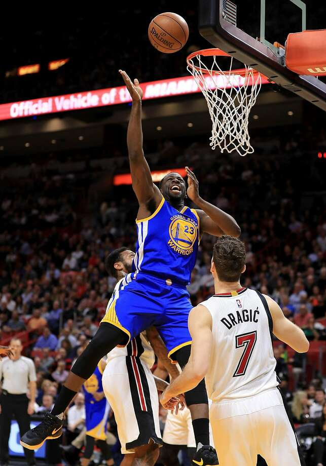 Draymond Green #23 of the Golden State Warriors drives over Goran Dragic #7 of the Miami Heat during a game  at American Airlines Arena on January 23, 2017 in Miami, Florida. Photo: Mike Ehrmann, Getty Images