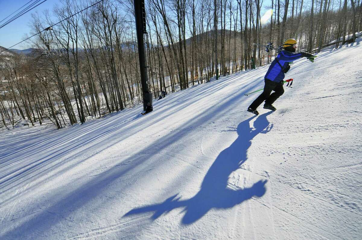 Saratoga Springs High School Alpine Racing Team assistant coach Glyn Chilton walks up the steep slope en route to the starting line to watch his skiers compete in the Section II ski championships slalom at Gore Mountain on Tuesday Feb. 15, 2011, in North Creek, N.Y. ( Philip Kamrass / Times Union archive)