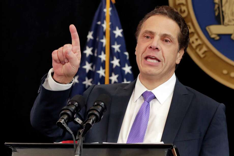 New York Gov. Andrew Cuomo delivers one of his State of the State addresses in New York's One World Trade Center building, Monday, Jan. 9, 2017. New York state must stand as an alternative to the policies and pronouncements of President-elect Donald Trump and show the nation progressive achievements, racial and religious tolerance and that big investments in education and infrastructure can create a dynamic economy that works for all, Cuomo said Monday. (AP Photo/Richard Drew) ORG XMIT: NYRD104 Photo: Richard Drew / AP