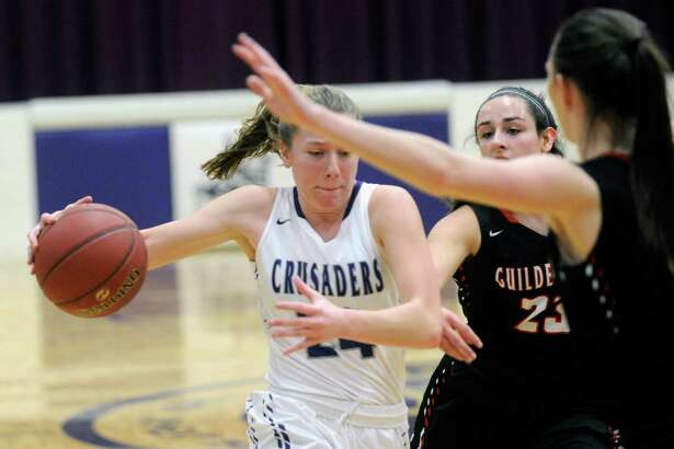 Catholic Central's Taylor Engster ,left, moves the ball against Guilderland during the first half of a girls' high school basketball game on Monday, Jan. 23, 2017, in Troy, N.Y. (Hans Pennink / Special to the Times Union) ORG XMIT: HP111