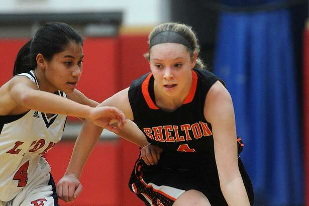 Shelton's Sarah Skoronski races the ball up the floor defended by Foran's Samantha Inthapanhya in the first half of their girls basketball game at Foran High School in Milford, Conn. on Monday, January 23, 2017.