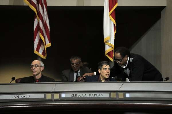 Supervisor Rebecca Kaplan speaks with Supervisor Larry Reid while council discussed city measures and resolutions related to the Ghost Ship fire during a city council meeting with several  at City Hall in Oakland, Calif., on Monday, January 23, 2017.