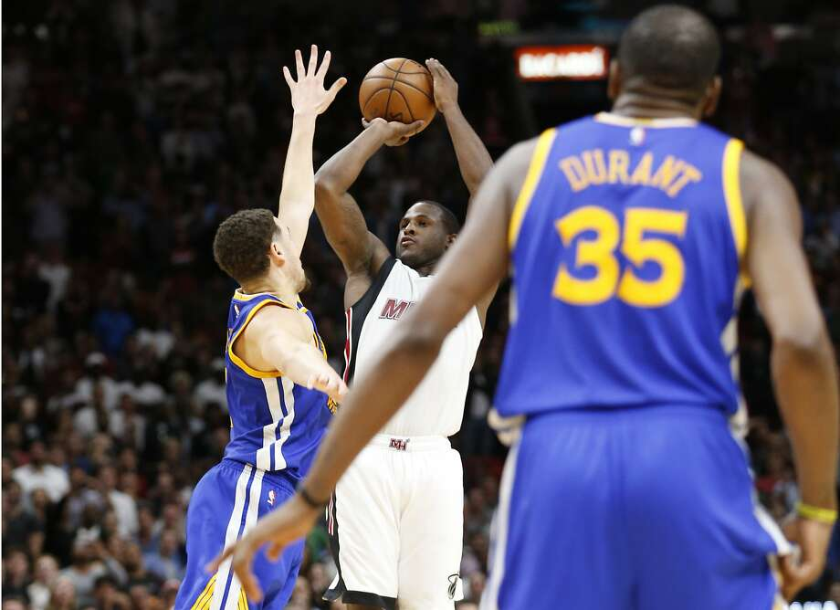 Miami Heat guard Dion Waiters, center, goes up for a three-point shot against Golden State Warriors guard Klay Thompson, left, as forward Kevin Durant (35) looks on during the last with 0.6 seconds of an NBA basketball game, Monday, Jan. 23, 2017, in Miami. Waiters had 33 points as the Heat defeated the Warriors 105-102. (AP Photo/Wilfredo Lee) Photo: Wilfredo Lee, Associated Press