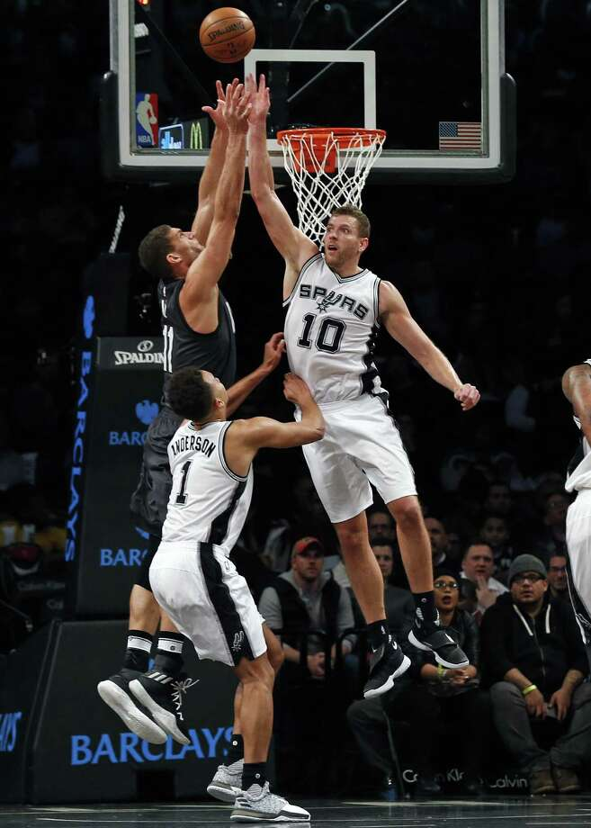 David Lee knocks the ball away from Brook Lopez during the second half at Barclays Center.  Lee had 15 points and seven rebounds off the bench, a unit that had four score in double figures. Photo: Adam Hunger / Associated Press / FR110666 AP