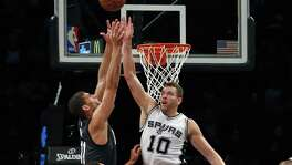 David Lee knocks the ball away from Brook Lopez during the second half at Barclays Center.  Lee had 15 points and seven rebounds off the bench, a unit that had four score in double figures.