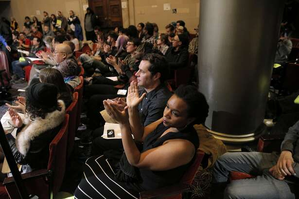 The public applauds during public comment while council discussed city measures and resolutions related to the Ghost Ship fire during a city council meeting with several  at City Hall in Oakland, Calif., on Monday, January 23, 2017.