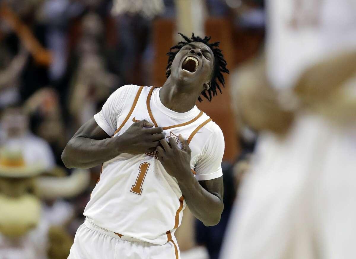 Texas guard Andrew Jones (1) celebrates the team's win over Oklahoma in an NCAA college basketball game, Monday, Jan. 23, 2017, in Austin, Texas. Texas won 84-83. (AP Photo/Eric Gay)