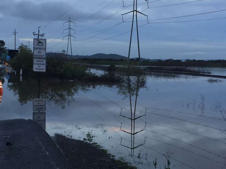 Novato's flood-prone Highway 37 is closed again. Photo shows flooded road after a storm in January 2017. Photo: California Highway Patrol / California Highway Patrol