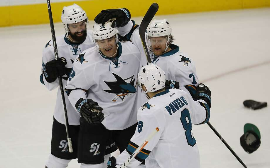 San Jose Sharks left wing Patrick Marleau, second from left, is congratulated by defensemen David Schlemko, from left, Paul Martin and center Joe Pavelski as hats shower on to the ice after Marleau scored his third goal against the Colorado Avalanche in the third period of an NHL hockey game Monday, Jan. 23, 2017, in Denver. The Sharks won 5-2. (AP Photo/David Zalubowski) Photo: David Zalubowski, Associated Press