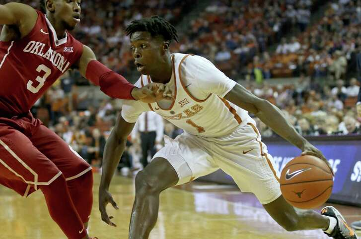 Texas guard Andrew Jones (1) looks for room around Oklahoma guard Christian James (3) during first half action Monday Jan. 23, 2017 at the Frank Erwin Center in Austin, Tx.