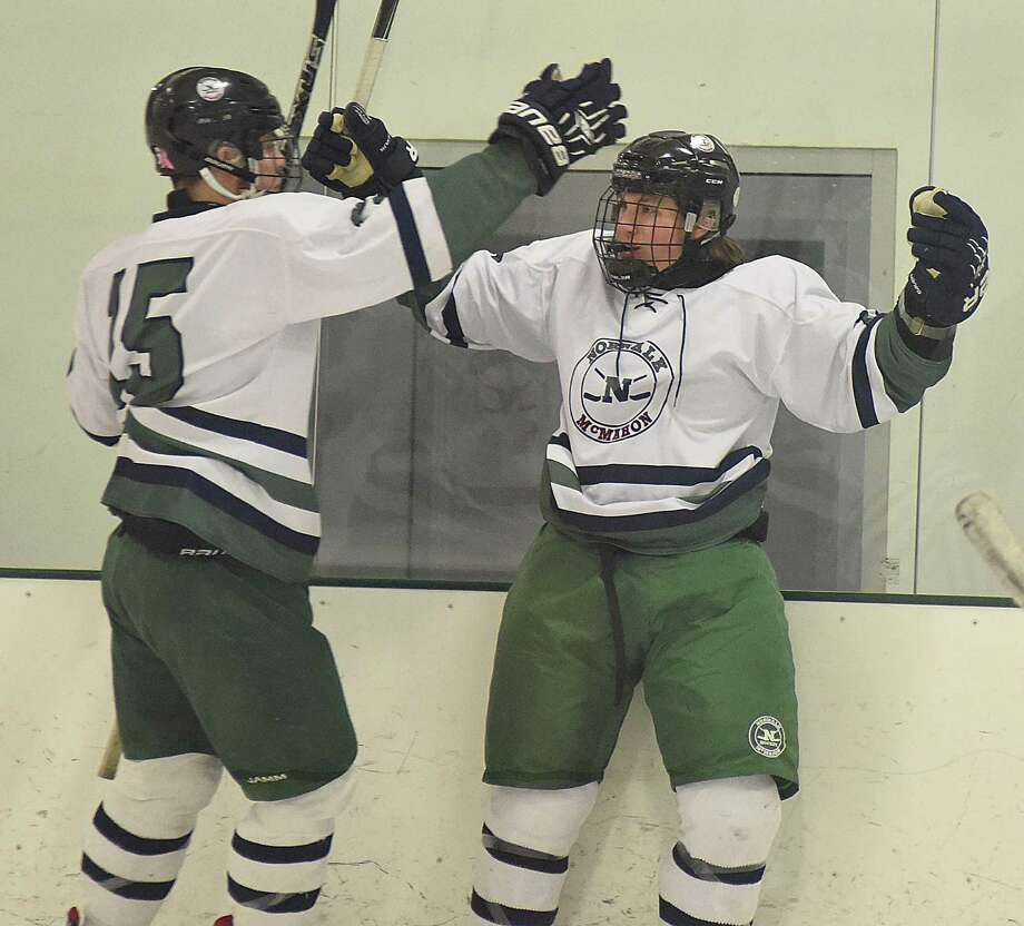 Norwalk-McMahon teammates Quinn Sandor, right, and Kevin Remson celebrate Sandor's short-handed goal in the first period of Monday afternoon's 6-3 victory over Wilton at the SoNo Ice House in Norwalk. Photo: John Nash / Hearst Connecticut Media / Norwalk Hour