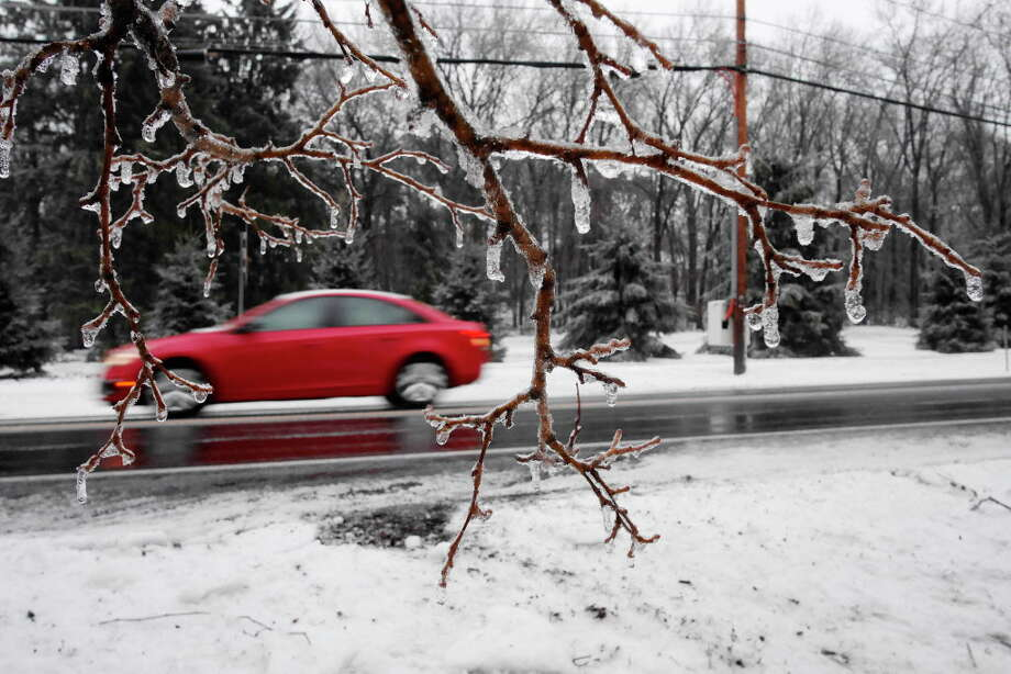 Ice covers the branches of trees as cars travel by on Old Niskayuna Road on Tuesday, Jan. 24, 2017, in Colonie, N.Y.    (Paul Buckowski / Times Union) Photo: STAFF, Albany Times Union / 20039518A