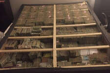 The U.S. Attorney's Office shared a photo of $20 million seized in a box spring following the arrest of a Brazilian national in scheme to launder proceeds of a pyramid scheme.