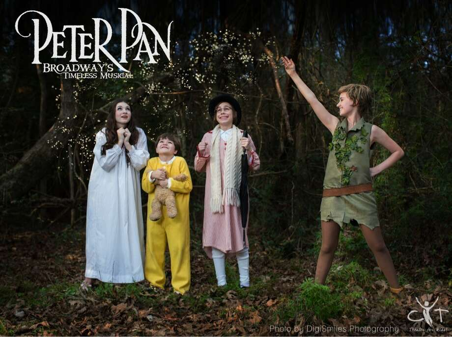 "Christian Youth Theatre opens ""Peter Pan""Jan. 27 at the Nancy Bock Center for the Performing Arts in The Woodlands. From left are the Darling children: Julia Johnson as Wendy; Ethan Johnson standing in for Pierce Buchan as Michael; and Zach Tonkin as John Darling. Sarah Yeates,14, performs the title role."