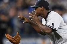 New York Yankees pitcher Luis Severino throws away his glove as he approaches Toronto Blue Jays' Justin Smoak after hitting him with a pitch during the second inning of a baseball game Monday, Sept. 26, 2016, in Toronto. (Frank Gunn/The Canadian Press via AP) ORG XMIT: FNG508