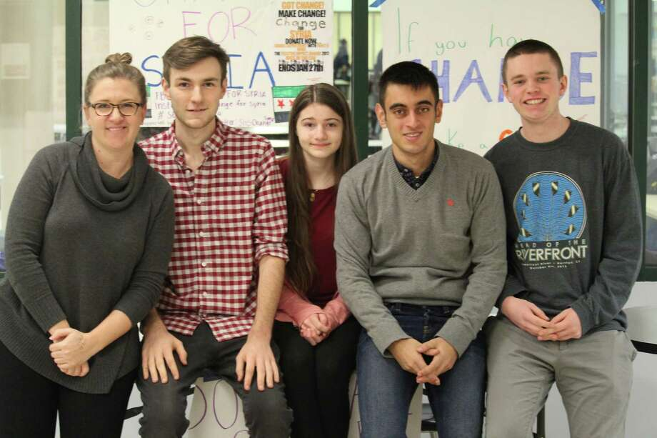 Members of Cathy Schager's contemporary world studies class who have come together to raise money for those affected by the Syrian Civil War. From left are Cathy Schager, Eli Debenham, Sarah Maybruck, Emir Beg and Michael Simons. Photo: Chris Marquette / Hearst Connecticut Media / Westport News