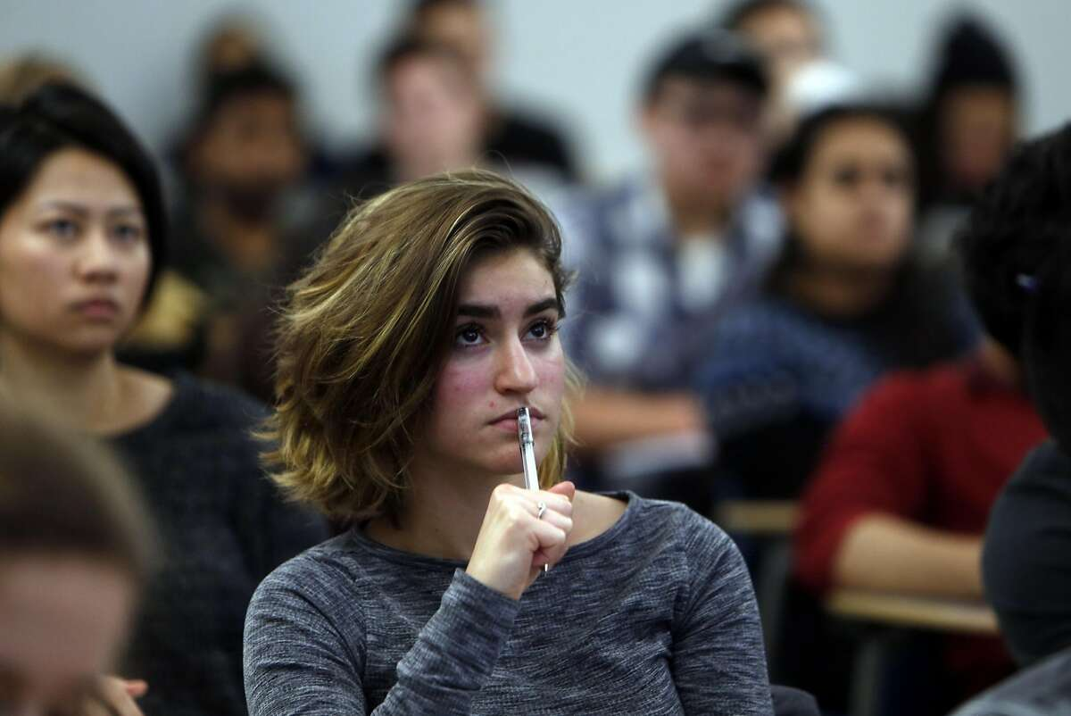 """Sophomore Nicole Madrazo listens to Good Food Institute Senior Scientist Christie Lagally speak during UC Berkeley's """"Plant-Based Meat Challenge Lab,"""" a class where students will compete to innovate new meat substitutes. Photographed in Berkeley, Calif., on Monday, January 23, 2017."""