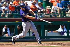 SCOTTSDALE, AZ - MARCH 09:  Nick Hundley #4 of the Colorado Rockies doubles in the fourth inning against the San Francisco Giants in the spring training game at Scottsdale Stadium on March 9, 2016 in Scottsdale, Arizona.  (Photo by Jennifer Stewart/Getty Images)