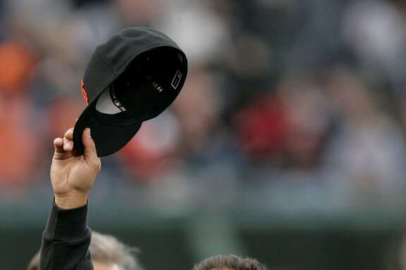 San Francisco Giants shortstop Omar Vizquel tips his hat to the crowd as he is honored for becoming the all-time leader in games played at shortstop before the start of a baseball game against the San Diego Padres in San Francisco, Friday, May 30, 2008. (AP Photo/Marcio Jose Sanchez)