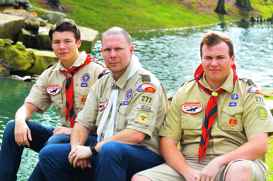"""Alex Dye, left, joins dad David and brother Evan Dye before theEagle Court of Honor forBoy Scouts of America Troop 277. Alex and Evan are twin brothers who will be joined in the ceremony by      their father David Dye who earned his Eagle in 1989, and grandfather,      James """"Jim"""" Dye who earned his Eagle in 1960, making the event unique for      the organization and family. Photo: N/a"""