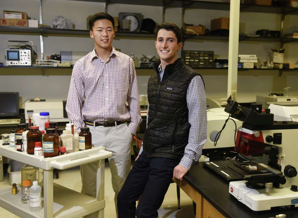 GHS seniors Derek Woo, left, and Ethan Novek pose in the science lab at Greenwich High School in Greenwich, Conn. Wednesday, Jan. 24, 2017. Woo and Novek are finalists in the 2017 Regeneron Science Talent Search, the prestigious pre-college science competition.
