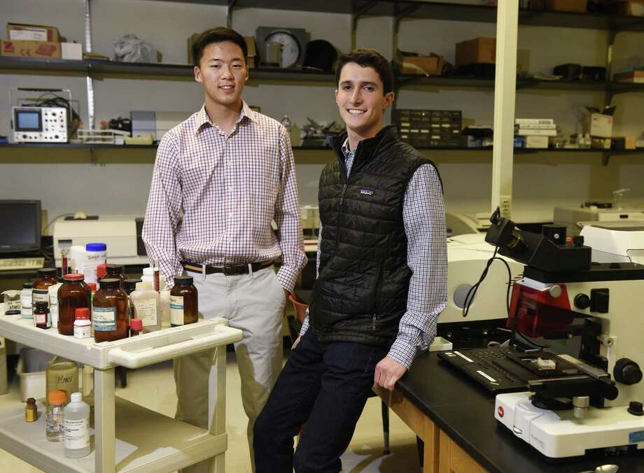 GHS seniors Derek Woo, left, and Ethan Novek pose in the science lab at Greenwich High School in Greenwich, Conn. Wednesday, Jan. 24, 2017. Woo and Novek are finalists in the 2017 Regeneron Science Talent Search, the prestigious pre-college science competition. Photo: Tyler Sizemore / Hearst Connecticut Media / Greenwich Time