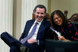 Lt. Gov. Gavin Newsom and Controller Betty Yee smile before Gov. Jerry Brown arrives to deliver the State of the State address at the Capitol in Sacramento, Calif. on Tuesday, Jan. 24, 2017.