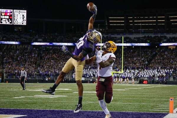 SEATTLE, WA - NOVEMBER 19:  Defensive back Kevin King #20 of the Washington Huskies makes an interception in the end zone against wide receiver N'Keal Harry #1 of the Arizona State Sun Devils on November 19, 2016 at Husky Stadium in Seattle, Washington.  (Photo by Otto Greule Jr/Getty Images)