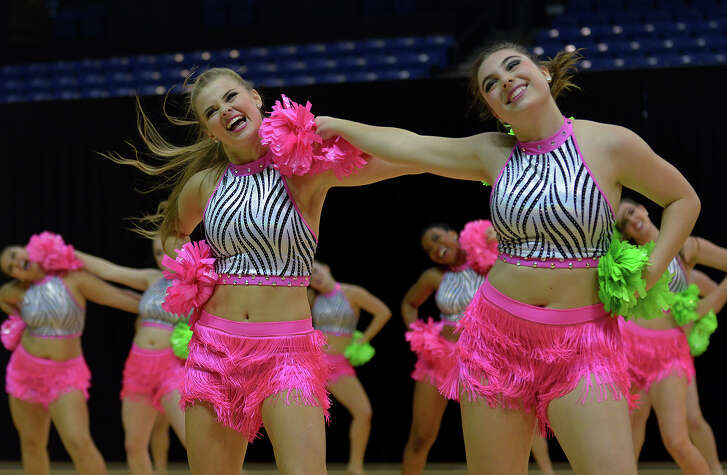"Katie Patrick, left, and Jenna Buchanan and the Langham Creek Bailadoras perform their Team Pom rountine to ""Juicy Wiggle"" during the Cypress-Fairbanks ISD Showoffs at the Berry Center on January 21, 2017. (Photo by Jerry Baker/Freelance)"