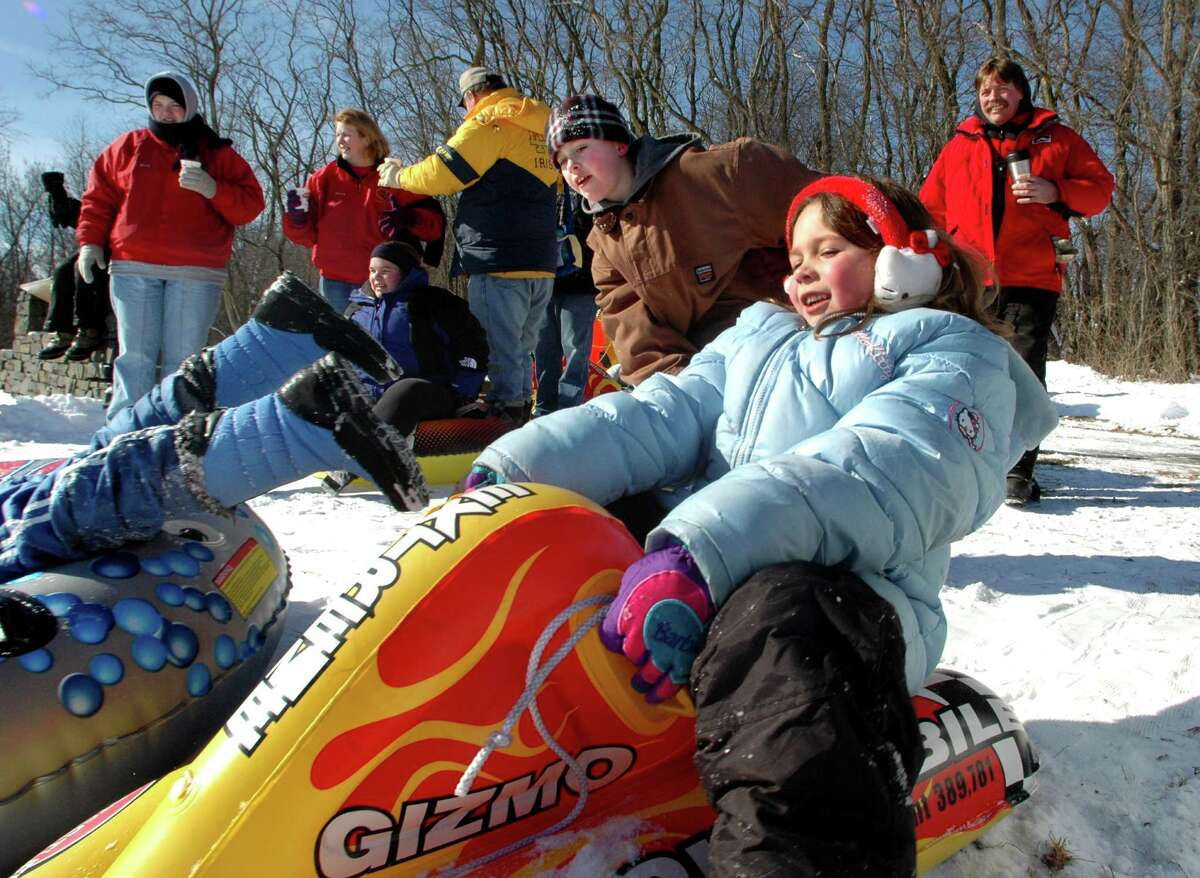Times Union staff photo by Cindy Schultz Jordyn Russom, 7, right, prepares to slide down the hill on her bullet during Frost Faire on Saturday Jan. 29, 2005, at the Saratoga National Historical Park in the Town of Saratoga, N.Y.