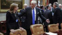 "President Donald Trump speaks with GM CEO Mary Barra before a meeting Tuesday at the Roosevelt Room of the White House.Trump told chief executives of the three biggest U.S. automakers that environmental regulations are ""out of control"" and promised he would remove obstacles for manufacturers and oil companies."