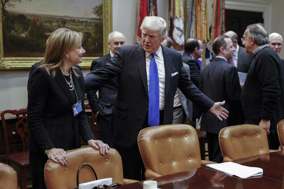 "President Donald Trump speaks with GM CEO Mary Barra before a meeting Tuesday at the Roosevelt Room of the White House.Trump told chief executives of the three biggest U.S. automakers that environmental regulations are ""out of control"" and promised he would remove obstacles for manufacturers and oil companies. Photo: Shawn Thew /Bloomberg News / © 2017 Bloomberg Finance LP"