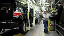 Toyota said it will add 400 jobs and invest $600 million at the Princeton SUV factory, shown here. Toyota says the investment was planned before the election.