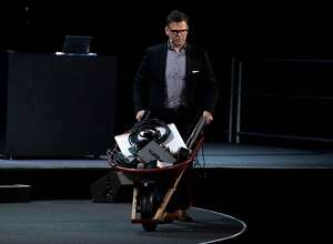 Rowan Trollope, Senior Vice President and General Manager, IoT and Applications, pushes a wheel barrow full of electronics on stage before introducing the new Cisco Spark Board,  a digital whiteboard with cloud-based interactive video conference functions during a Cisco event in San Francisco, California on January 24, 2017.