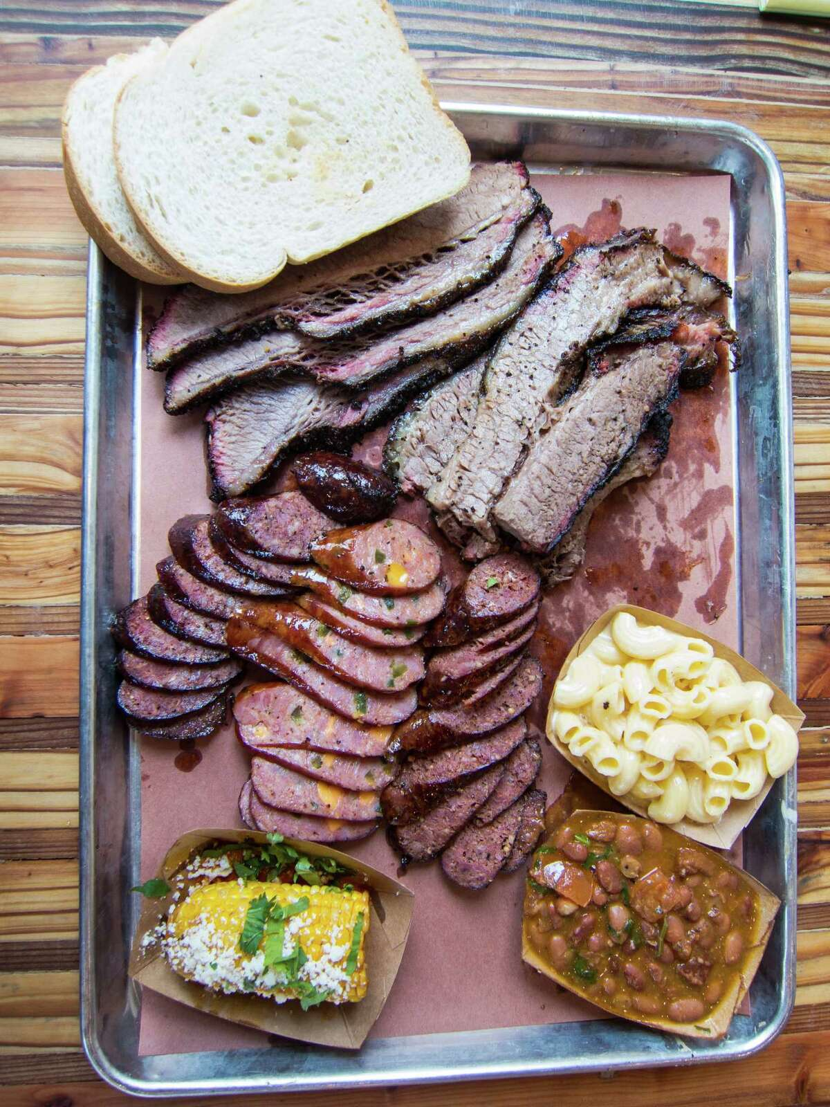 Brisket and sausage with macaroni and cheese, beans and elote (corn) at The Pit Room