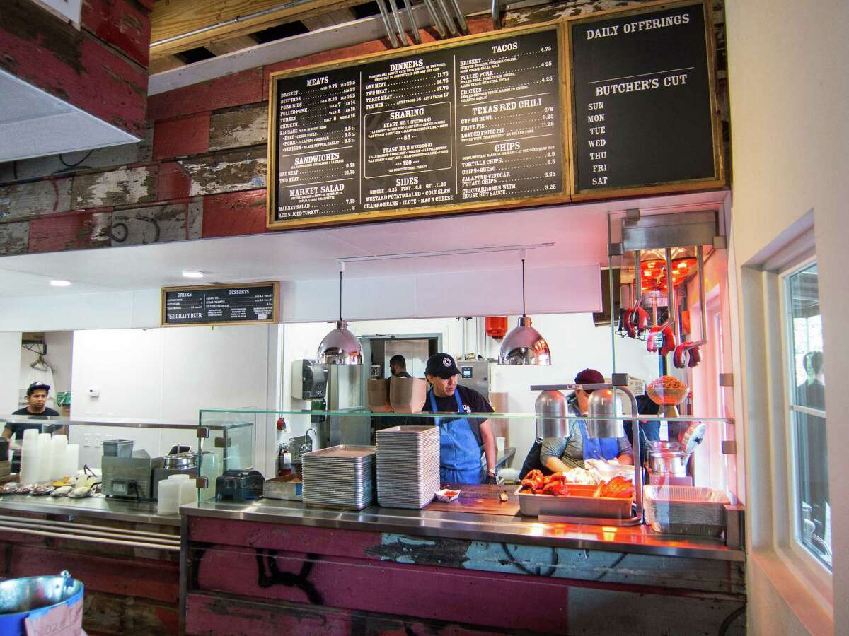 Customers place their orders at the counter and the food is prepared in back at Hinze's Bar-B-Q in Wharton.