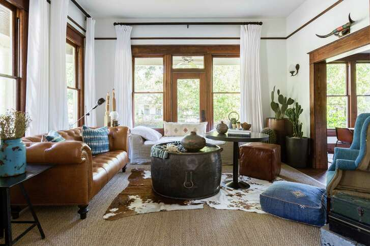 The living room in the Heights home of Aimee Woodall and Tyler Crabtree.