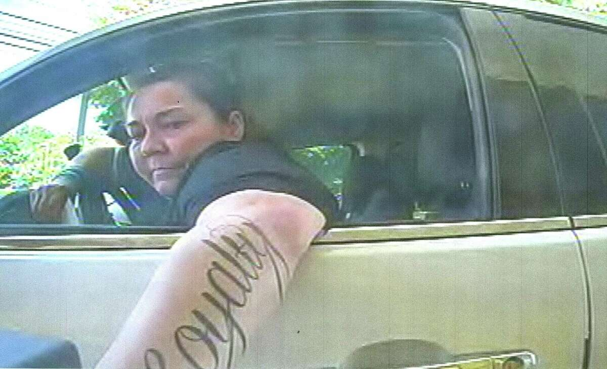 Police have released surveillance photos of a woman who they say was involved in several counterfeit check cashing incidents in the Fairfield County area in the summer of 2016.