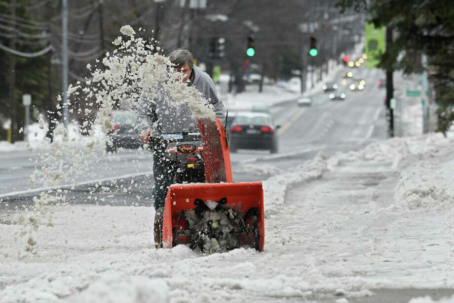 5A person uses a snowblower to clear a sidewalk along Western Ave. on Tuesday, Jan. 24, 2017 in Albany, N.Y. (Lori Van Buren / Times Union) Photo: Lori Van Buren